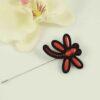 Broche libélula rojo y negro.